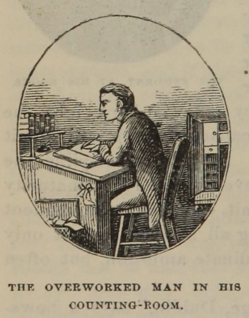 overworked man at desk